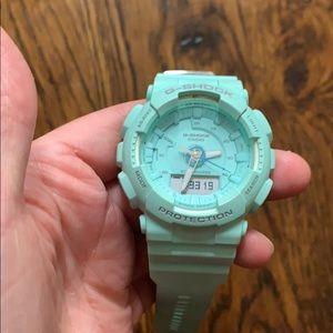 Women's light blue/green gshock watch